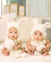 Two babies in bunny suits